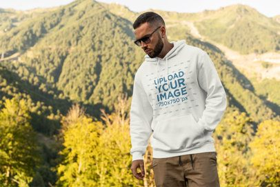Mockup of a Man at the Mountains Wearing a Pullover Hoodie and Sunglasses 2766-el1
