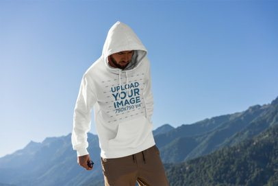Mockup of a Man Wearing a Hoodie with Mountains in the Background 2770-el1
