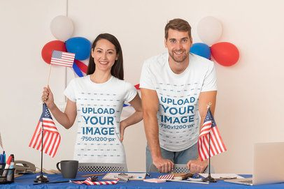 T-Shirt Mockup of a Woman and a Man in a Polling Station 31920