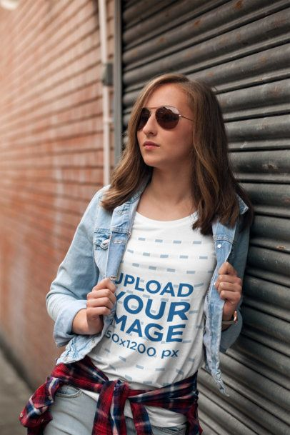 T-Shirt Mockup Featuring a Young Woman Wearing Sunglasses 2757-el1
