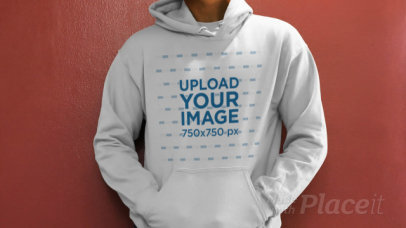 Pullover Hoodie Video Featuring a Man Against a Plain-Colored Wall 32017