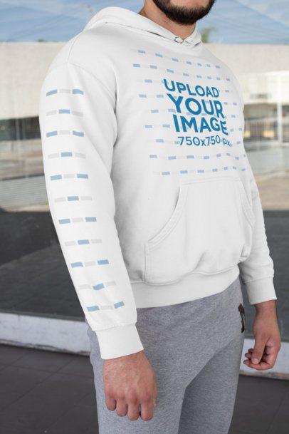 Mockup of a Bearded Man Wearing a Hoodie with Printed Sleeves 31485