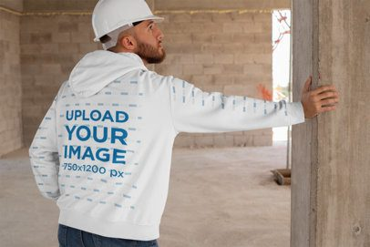 Hoodie Mockup with Printed Sleeves Featuring a Man at a Construction Site 31541