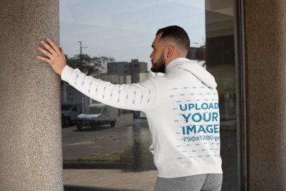 Back-View Mockup Featuring a Bearded Man Wearing a Hoodie with a Customizable Sleeve 31490