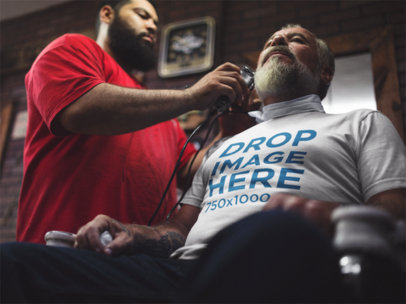 Tee Mockup of an Older Man at a Barbershop a12065