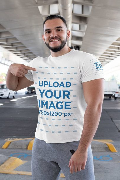 Mockup of a Muscled Man Pointing at His T-Shirt 31477