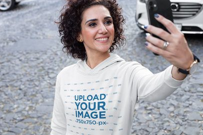 Pullover Hoodie Mockup Featuring a Woman Taking a Selfie 31618