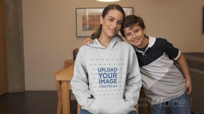 Hoodie Video of a Mom and Her Son Posing in the Living Room 32338