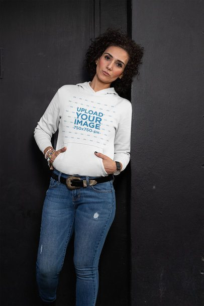 Pullover Hoodie Mockup of a Middle-Aged Woman Posing Against a Dark Wall 31619