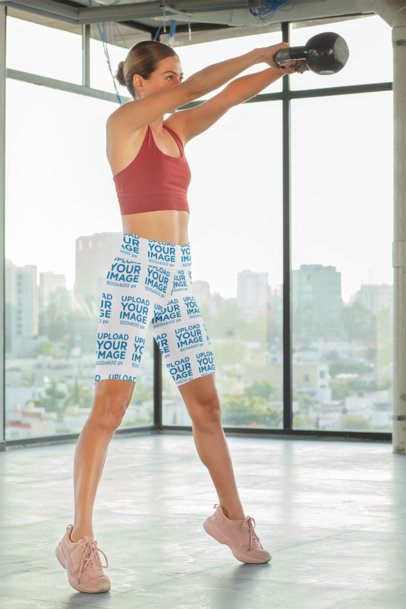 Bike Shorts Mockup of a Woman Using a Kettlebell 31504