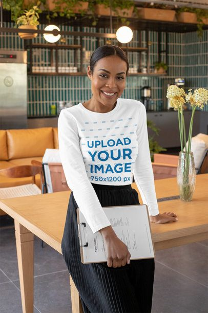 Mockup of a Middle-Aged Woman Wearing a Long Sleeve Tee at a Modern Office 31709