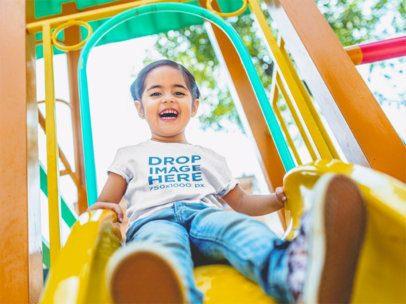 Little Girl Riding Down a Slide T-Shirt Mockup a12108