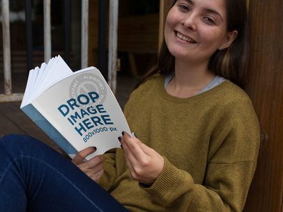 Thick Paperback Book Mockup of a Young Smiling Woman Reading a12033