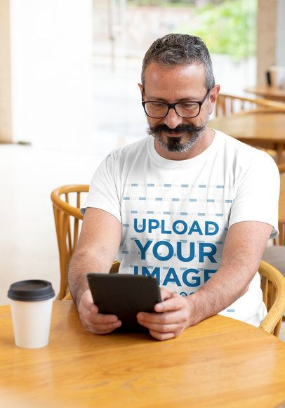 T-Shirt Mockup Featuring a Man Reading at a Cafe 31712