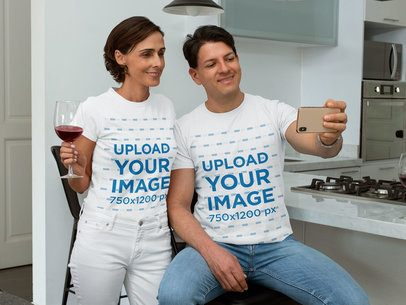 T-Shirt Mockup of a Middle-Aged Couple Taking a Selfie at Home 31679