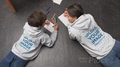 Hoodie Video Featuring a Woman and Her Son Drawing on the Floor 32339