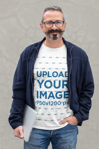 T-Shirt Mockup of a Slick Middle-Aged Man Holding a Laptop 31714