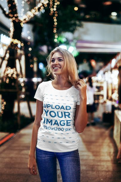 T-Shirt Mockup of a Woman Holding Her Hair on the Street at Night 2819-el1