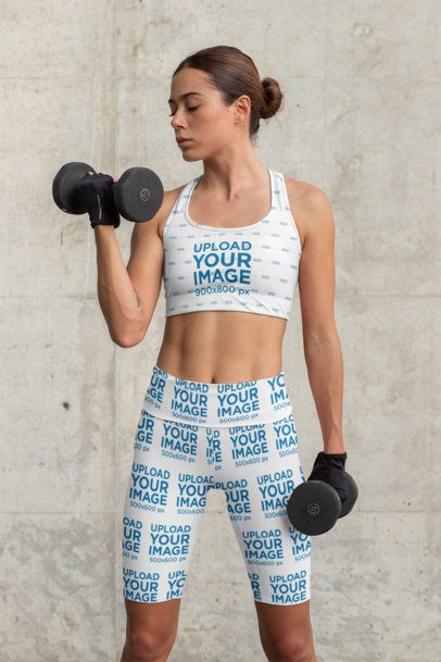 Mockup of a Woman Exercising with a Sports Bra and Bike Shorts 31511