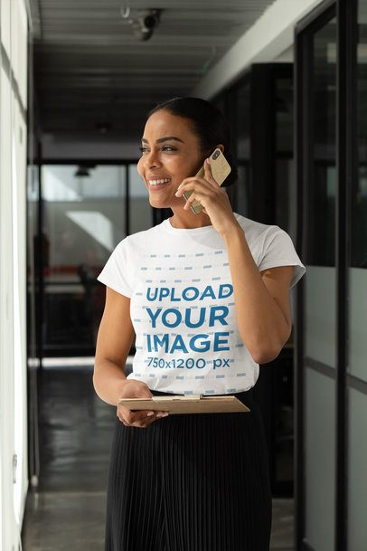 T-Shirt Mockup of a Woman Speaking on the Phone at an Office Hallway 31700