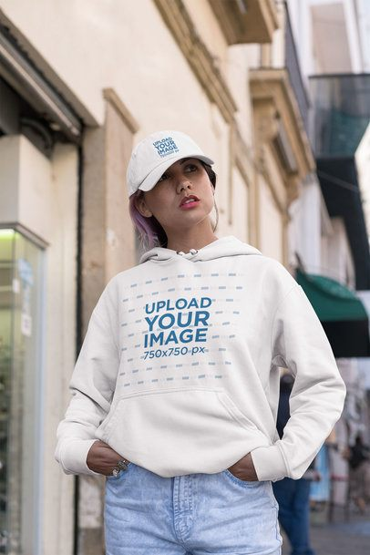 Hoodie Mockup of a Woman Wearing a Dad Hat with Hands in Her Pockets 31187
