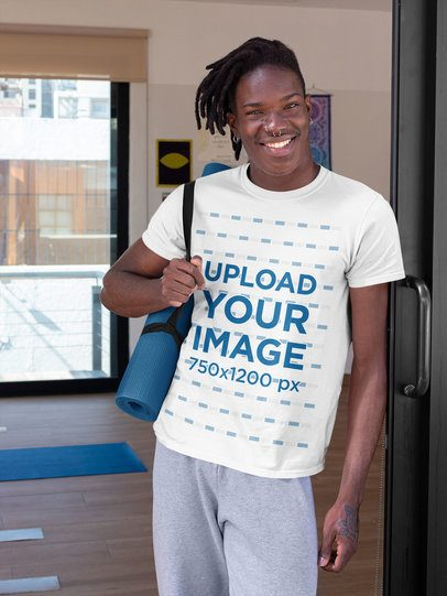 T-Shirt Mockup of a Smiling Man Carrying a Yoga Mat 31108