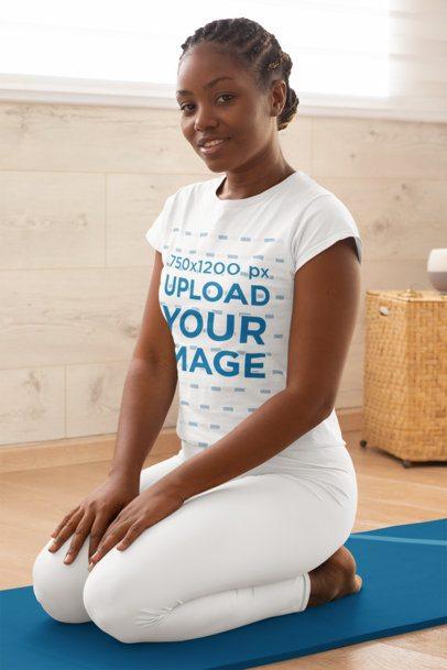 T-Shirt Mockup of a Kneeled Woman Doing Yoga 31087