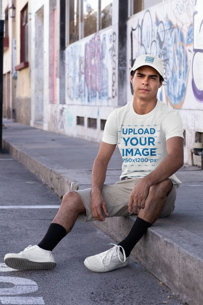 Mockup of a Man Wearing a T-Shirt and a Dad Hat at an Urban Scenario 31165