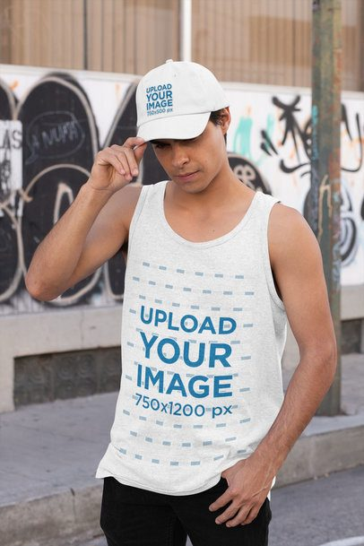 Mockup of a Man Wearing a Tank Top While Holding His Dad Hat 31168