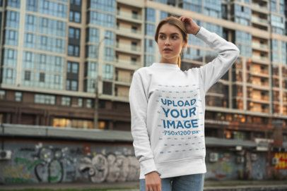 Crewneck Sweatshirt Mockup Featuring a Young Woman Posing by Some Apartment Buildings 2840-el1