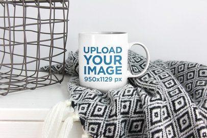 Mockup of a Coffee Mug Placed Over a Blanket 2947-el1