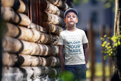 T-Shirt Mockup of a Serious Boy Next to a Cabin 2922-el1