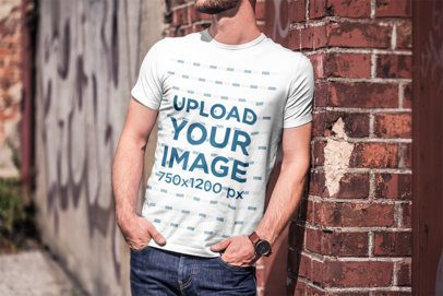 T-Shirt Mockup of a Bearded Man Leaning on a Brick Wall 2963-el1