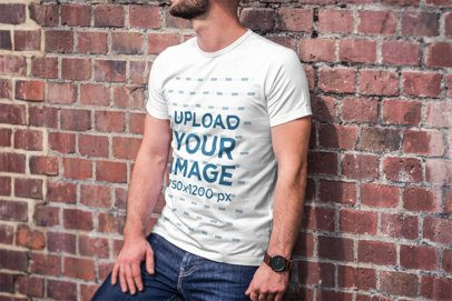 Mockup of a Bearded Man Wearing a T-Shirt and Leaning on a Brick Wall 2964-el1