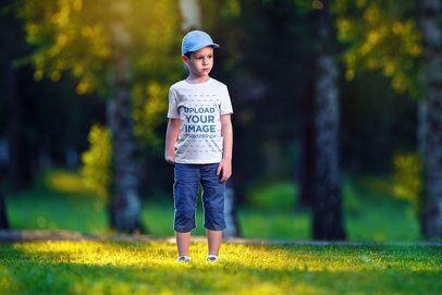 Mockup of a Boy Wearing a T-Shirt at the Park 2933-el1