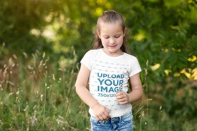 T-Shirt Mockup of a Young Girl Playing in Nature 2906-el1