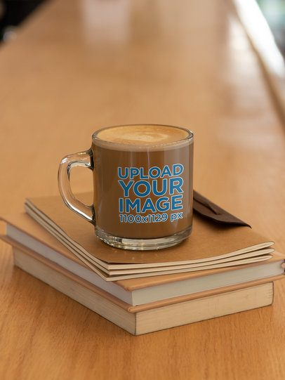 Mockup of a Glass Mug Placed Over Some Books 31747