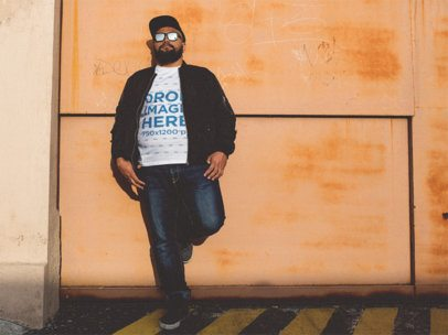 T-Shirt Mockup of a Plus Size Urban Style Guy Leaning Against a Wall a12285