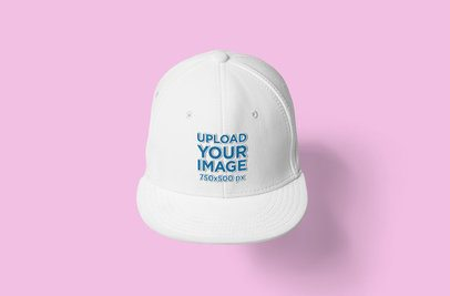Mockup of a Snapback Hat Placed Against a Colored Background 3099-el1