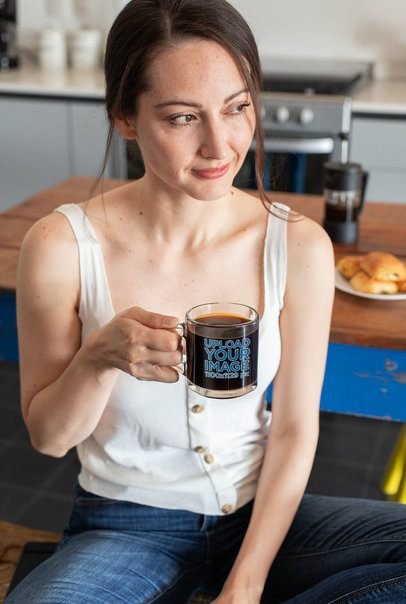 Clear Mug Mockup of a Woman Enjoying a Coffee in Her Kitchen 31749