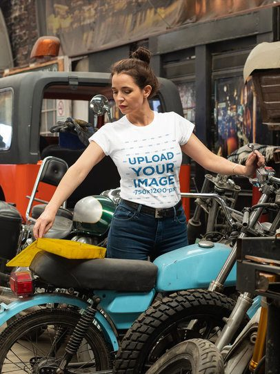 T-Shirt Mockup Featuring a Woman Repairing a Motorcycle 31797