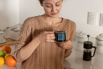 Mockup of a Woman Drinking Coffee From a Glass Mug by a Kitchen Counter 31755