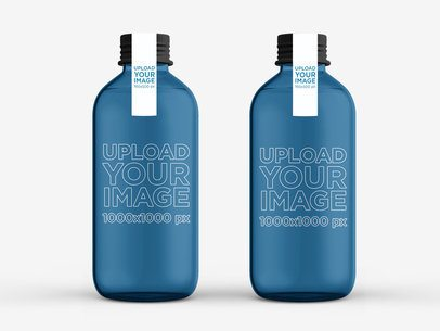 Minimal Packaging Mockup Featuring Two Glass Water Bottles Against a Plain Color Background 3060-el1
