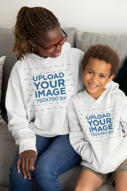 Hoodie Mockup of a Mom and Her Son Hugging on a Couch 32661
