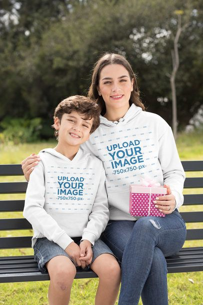 Hoodie Mockup of a Boy and His Mom Sitting on a Park Bench 32636
