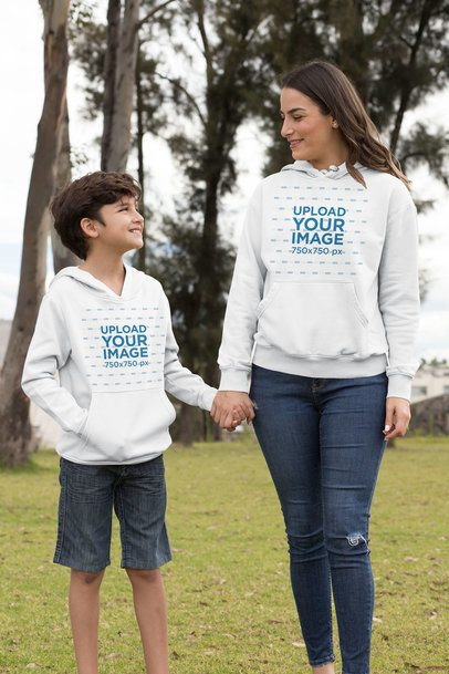 Hoodie Mockup of a Mom and Her Son Holding Hands in the Park 32635