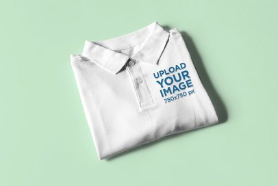 Mockup of a Folded Polo Shirt Placed on a Solid Surface 3091-el1