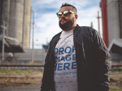 T-Shirt Mockup of a Cool Young Man Wearing a Black Jacket with Sunglasses a12287
