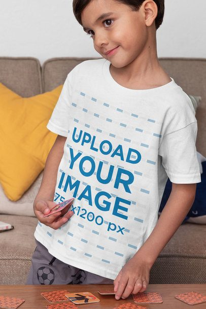 T-Shirt Mockup Featuring a Kid Playing a Memory Card Game 32165