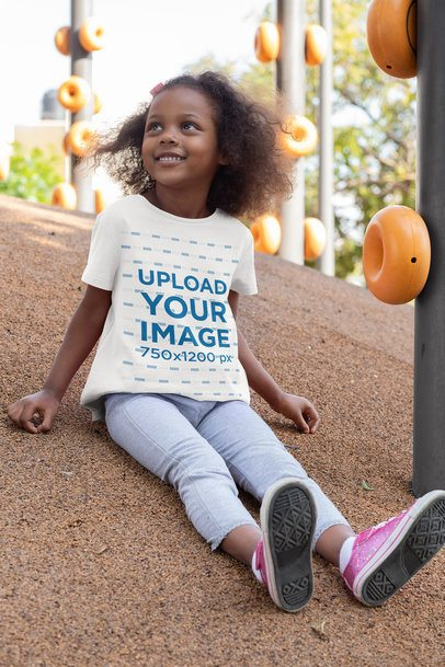 Mockup of a Little Girl Wearing a T-Shirt at a Park 32177